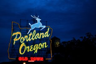 Photo of Portland, Oregon, White Stag sign at night